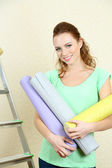 Young woman doing renovation in new house — Stock Photo