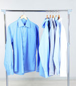 Office male clothes on hangers, on gray background — Stock Photo