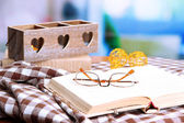 Composition with old book, eye glasses, candles, and plaid on bright background — Stock Photo