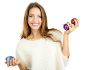 Beautiful smiling girl with Christmas toys isolated on white — Stock Photo