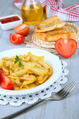 Fried potatoes on plate on wooden table close-up — Stock Photo