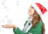 Yeni yıl şapkası üzerinde beyaz izole gülümseyen kız güzel — Stok fotoğraf