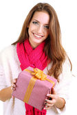 Beautiful smiling girl with gift isolated on white — Stock Photo