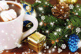 Cup of hot cacao with Christmas decorations close up — Stock Photo