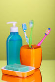 Bathroom set on green background — Stock Photo