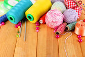 Handicraft supplies on wooden table close-up — Stock Photo