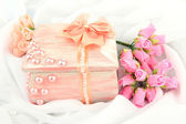 Beautiful hand made casket and flowers, isolated on white cloth background — Stock Photo
