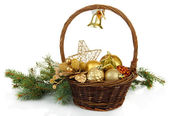 Christmas decorations in basket and spruce branches isolated on white — Stockfoto