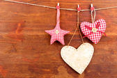 Decorative heart and star on rope, on wooden background — Stock Photo