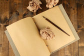Crumpled paper balls with notebook and ink pen — Stock Photo