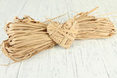 Decorative straw for hand made and heart of straw, on wooden background — 图库照片