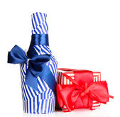 Bottle packed in gift paper with gift isolated on white — Stock Photo