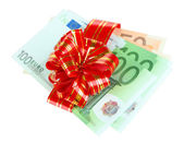 Euro banknotes with red bow isolated on white — Stock Photo