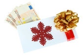 Euro banknotes in envelope with bow isolated on white — Stock Photo