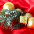 Beautiful Christmas decor on red satin cloth — Stock Photo #36385439