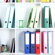 White office shelves with folders and different stationery, close up — Stock Photo