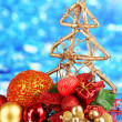 Composition of Christmas balls on blue background — Stok fotoğraf