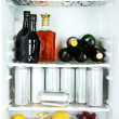 Stock Photo: Refrigerator full of bottles with alcoholic drinks