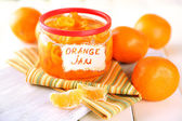 Orange jam with zest and tangerines, on white wooden table — Stock Photo