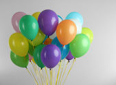 Colorful balloons on grey background — Stock Photo