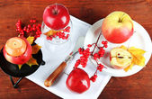 Composition with apples and candle on napkin on wooden background — Stockfoto