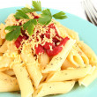 Rigatoni pasta dish with tomato sauce close up — Stok fotoğraf