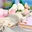 Composition with old book, eye glasses, candles, flowers and plaid on bright background — 图库照片