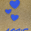 Blue hearts made of felt on golden background — Stockfoto