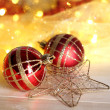 Christmas ornaments and garland on wooden table close-up — ストック写真