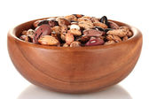 Wooden bowl with beans isolated on white — Stock Photo