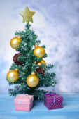 Decorative Christmas tree, on light background — Stock Photo
