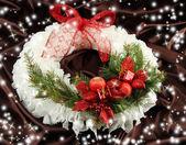 Christmas wreath on fabric background — Stock Photo