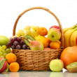 Assortment of exotic fruits in basket isolated on white — Stock Photo
