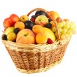 Still life of fruit in basket isolated on white — Stock Photo