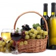 Bottles and glasses of wine and grapes in basket, isolated on white — Stock Photo #36484043