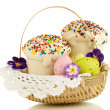 Stock Photo: Easter cakes with eggs in wicker basket isolated on white