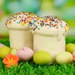 Easter cake with sugar glaze and eggs on grass — Stock Photo