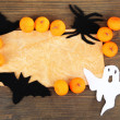 Old paper with Halloween decorations on grey wooden background — Foto de Stock