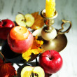 Composition with apples and candles on wooden background — Stok fotoğraf