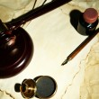 Wooden stamp, gavel and old papers, close up — Stock Photo