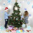 Kids decorating Christmas tree with baubles in room — Stock Photo #36486243