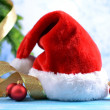 Composition with Santa Claus red hat and Christmas decorations on light background — Foto de Stock