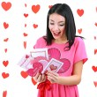 Attractive young woman with cards on Valentine Day — Stock Photo