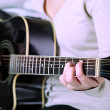 Stock Photo: Acoustic guitar in female hands, close-up