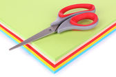 Colorful cardboard and scissors on white background — Stock Photo