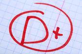 Grade D written on an exam paper — Stock Photo