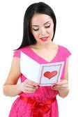 Attraktiv ung kvinna med valentine kort isolerat på vit — Stockfoto