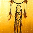 Beautiful dream catcher on yellow background with lights — Stock Photo