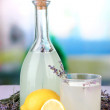 Stock Photo: Lavender lemonade,in glass bottle, on violet wooden table, on bright background