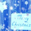 Signboard with words Merry Christmas on blue wooden table background close-up — Foto de Stock